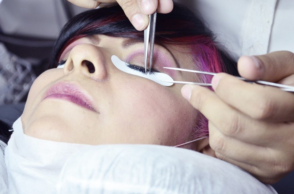 Eyelash extensions procedure - close-up