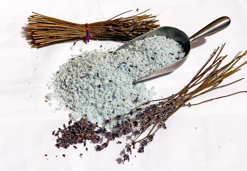 A bunch of lavender bath salt and some dried lavender