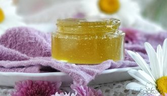 A jar of DIY face mask with aloe vera gel and honey
