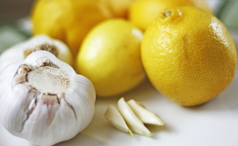 A bunch of lemons and a few cloves of garlic