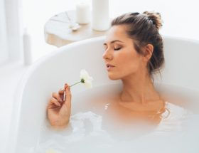 How to treat dehydrated skin - a woman soaking in a tub full of hydrating soak
