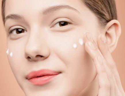 A girl applying acne spot treatment