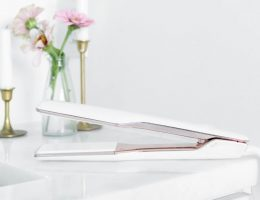 A quality, white ceramic flat iron hair straightener