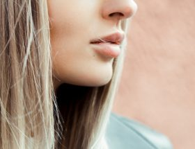 A girl using DIY lip masks to keep her lips soft, moisturized and nourished…