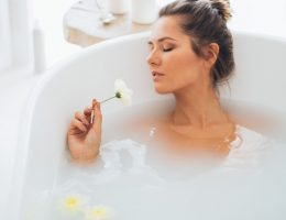 A girl taking a soothing DIY oatmeal bath