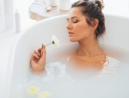 A girl taking a soothing DIY oatmeal bath