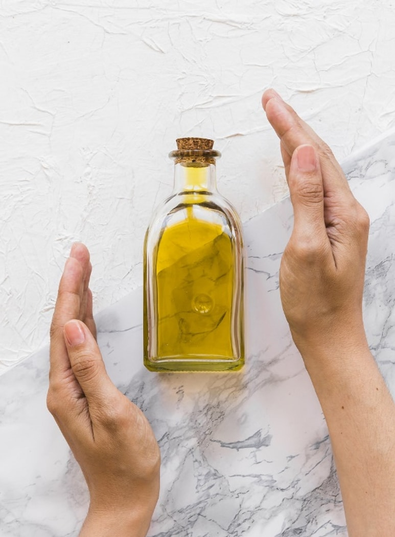 A bottle of argan oil for hair growth and repair