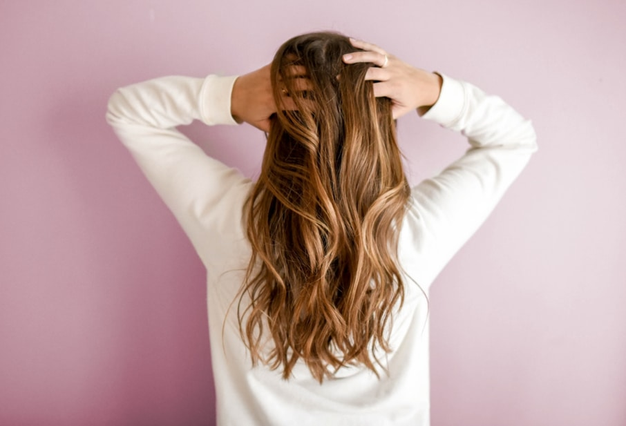 A girl with beautiful hair due to the usage of some of the best oils for hair care
