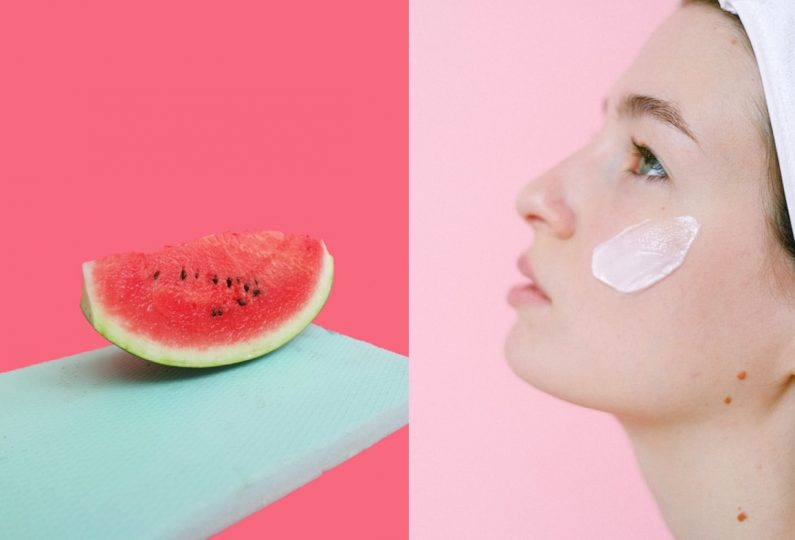 A girl trying out the best watermelon skincare products
