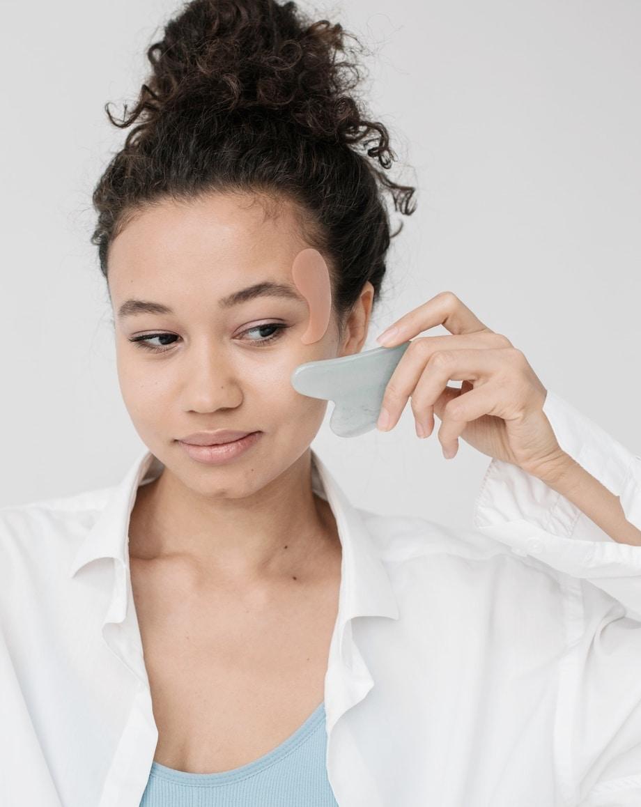 Facial massage as a part of a regular night skin care regimen