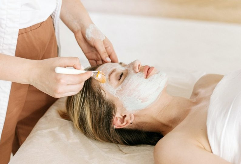 A girl using multi-masking to treat different areas of her face separately