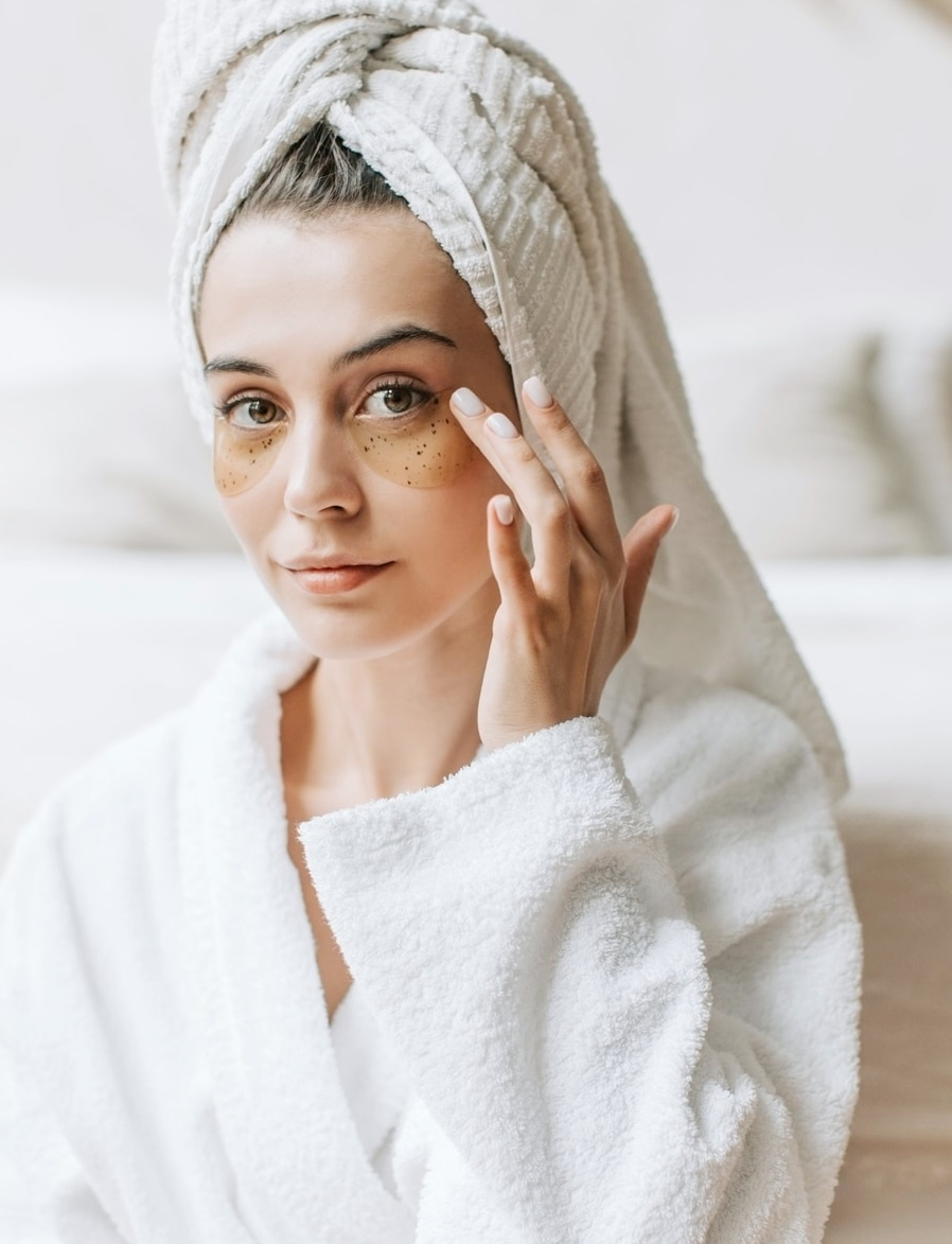 A girl using anti aging skin care products such as serums, creams and under eye treatments
